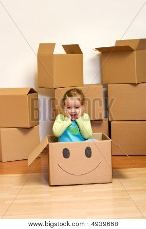 Little Girl In Cardboard Box - Moving Concept