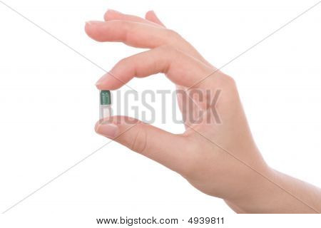Hand Holding A Capsule Or Pill