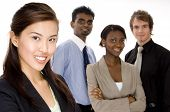 stock photo of ethnic group  - four attractive individuals make a young diverse business team - JPG