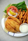 foto of hogfish  - fried fish lunch with french fries and tomato
