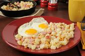 stock photo of hash  - Southern style hash browns with diced ham and eggs - JPG