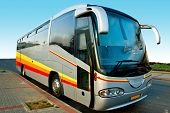 picture of motor coach  - Front view of a big modern tour bus parked by the side of the road - JPG