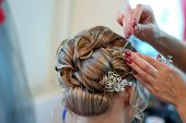 picture of brooch  - A bride at hairdressing salon before wedding - JPG
