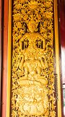 Ornament Wooden Door Of Thai Temple In Ubosot Wat Raja Mon Thian , Chiangmai Thailand