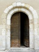 picture of wooden door  - Arched medieval church door with stone lintel - JPG