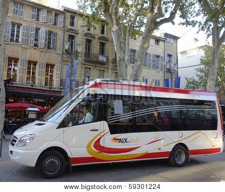 Aix en Bus minibus in medieval part of Aix en Provence, France