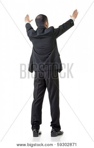 Rear view of Asian business man raising hand to put something over his head, full length isolated on white.