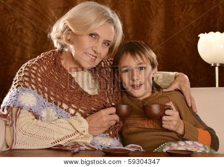 Senior woman dring coffee with grandson