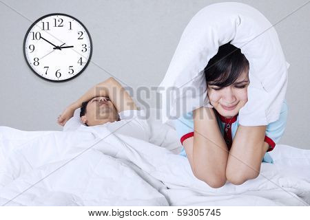 Woman Suffering On A Bed