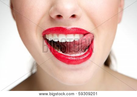 Woman Licking Teeth With Tongue