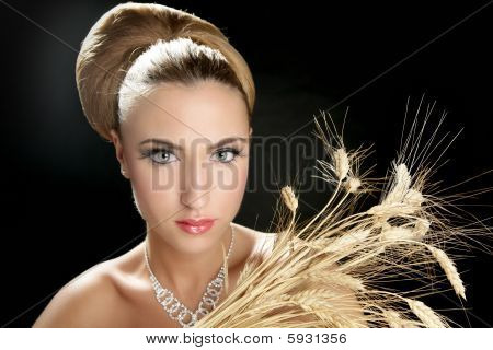 Blond Fashion Woman Holding Wheat Spike