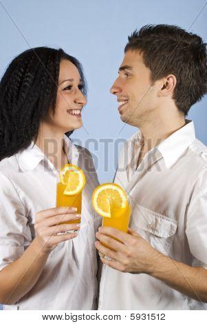 Happy Young Couple Wioth Fresh Orange Juice