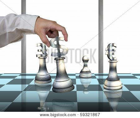 Hand Playing Chess With Money Symbol Pieces On Table