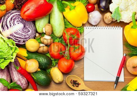 Fresh Vegetables Composition on the Wooden Background and Notebook for Recipes or Menu