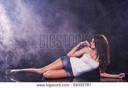 Young Sexy Woman. Water And Smoke Studio Photo.