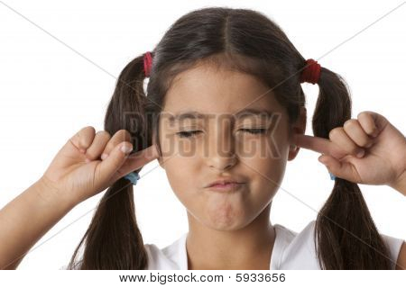 Little girl is closing her ears with her fingers