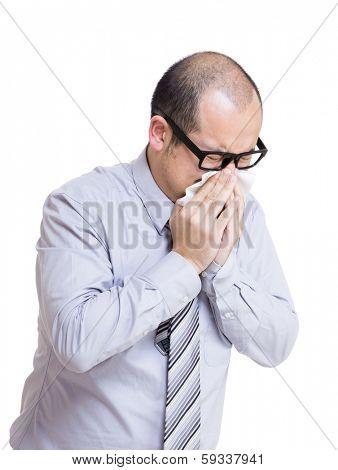 Businessman sneezes