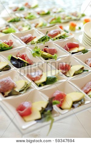 Cheese And Ham Appetizers On A Buffet