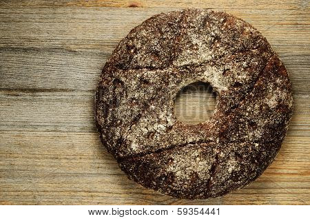 Finnish Traditional Round Bread On A Wooden Board