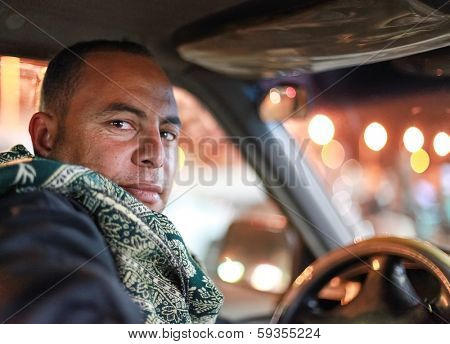 DAHAB, EGYPT - JANUARY 1, 2011: Portrait of the taxi driver. Taxi is favourite transport for western tourists visiting Egypt.