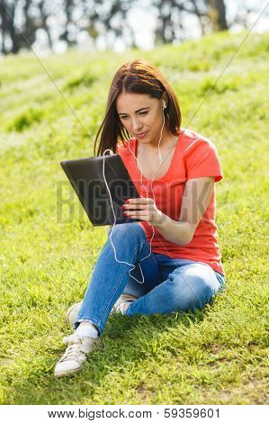 Beautiful Woman And Tablet Pc