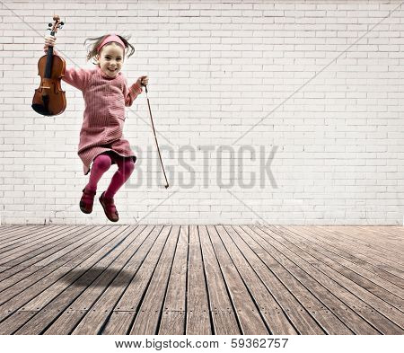little girl with violin jumping on a room with white bricks wall and wood floor