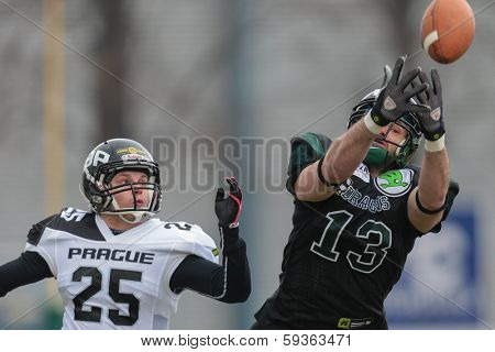 VIENNA,  AUSTRIA - APRIL 6 DB Pavel Klem¡ (#25 Panthers) and WR Thomas Haider (#13 Dragons) fight for the ball during the AFL football game on April 6, 2013 in Vienna, Austria.