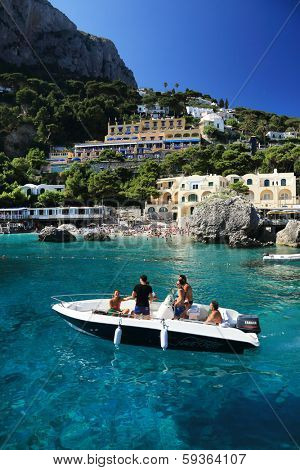 CAPRI - JUNE 02 2013 : People enjoying the summer sun on the shores of Capri Island, Italy, Europe