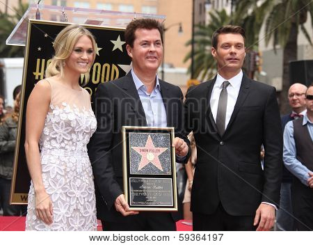 LOS ANGELES - MAY 23:  Carrie Underwood, Ryan Seacrest & Simon Fuller arrives to the Walk of Fame Ceremony for Simon Fuller  on May 23, 2011 in Hollywood, CA