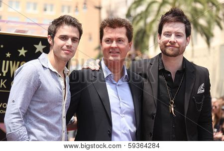 LOS ANGELES - MAY 23:  Kris Allen, Simon Fuller & David Cook arrives to the Walk of Fame Ceremony for Simon Fuller  on May 23, 2011 in Hollywood, CA