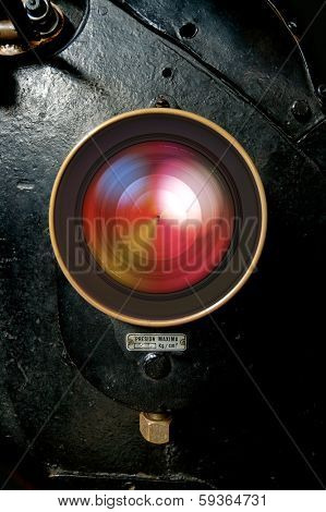 Lens embedded in a retro locomotive background