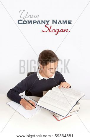 Schoolgirl consulting a dictionary while writing an essay