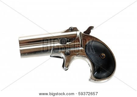 Antique derringer isolated over white
