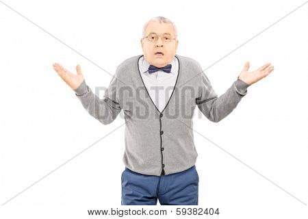 Confused senior man gesturing with hands isolated on white background