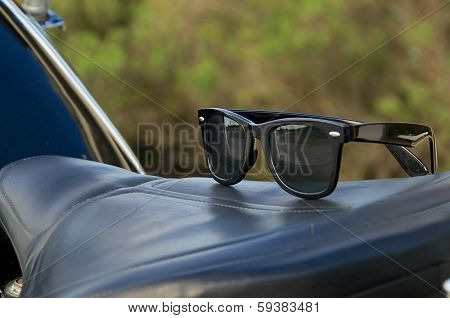 Sunglasses On Motorcycle Saddle