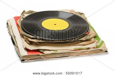 Stack of old vinyl records isolated on white