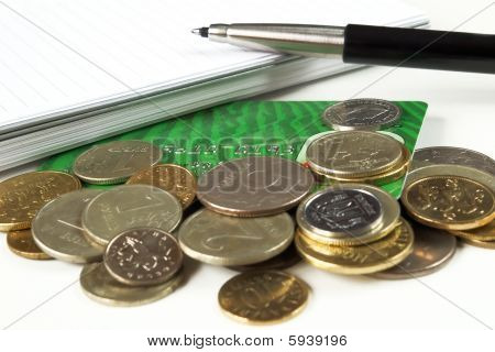 pen notepad and money