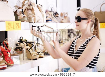 Young woman in the shoe shop