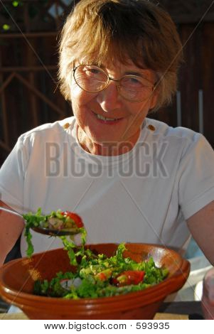 Happy Eating Senior Woman