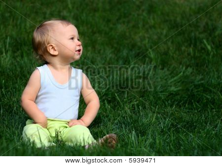 Little Boy On A Grass