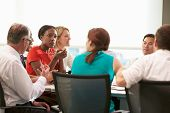 pic of fifties  - Group Of Businesspeople Meeting Around Boardroom Table - JPG