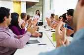 picture of congratulation  - Businesswoman Addressing Meeting Around Boardroom Table - JPG