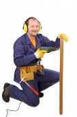 pic of muffs  - Worker in ear muffs with drill and board - JPG