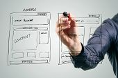 picture of drawing  - designer drawing website development wireframe with black marker - JPG