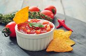 foto of chillies  - Bowl of salsa with tortilla chips tomatos and chilli pepper closeup
