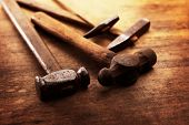picture of blacksmith shop  - Old Hammers on a old wooden workdesk - JPG