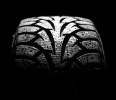picture of asymmetrical  - winter car tyre on a black background - JPG