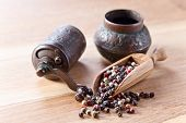 pic of peppercorns  - black white and red peppercorns on wooden table - JPG