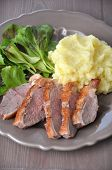 stock photo of duck breast  - Roasted Duck Breast with dumplings on a plate - JPG