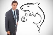 stock photo of loan-shark  - Serious businessman standing with hand on hip against loan shark illustration - JPG